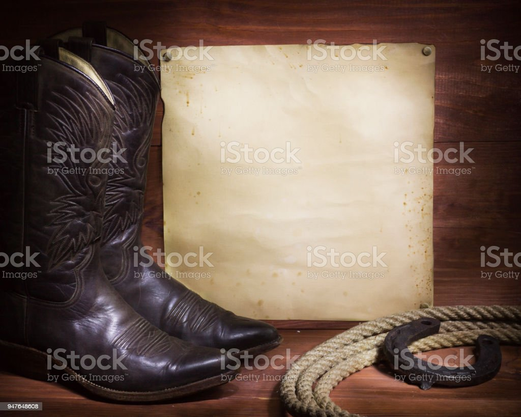 cowboy background with western shoes and lasso and paper stock photo