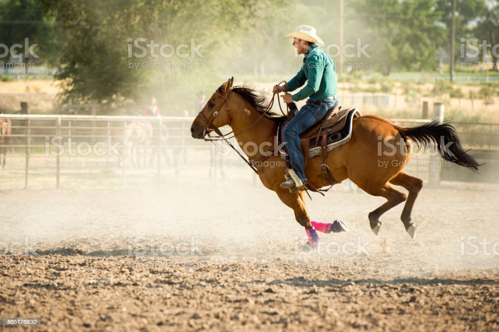 Cowboy Barrel Racing In The Arena At A Local Rodeo Stock Photo Download Image Now Istock