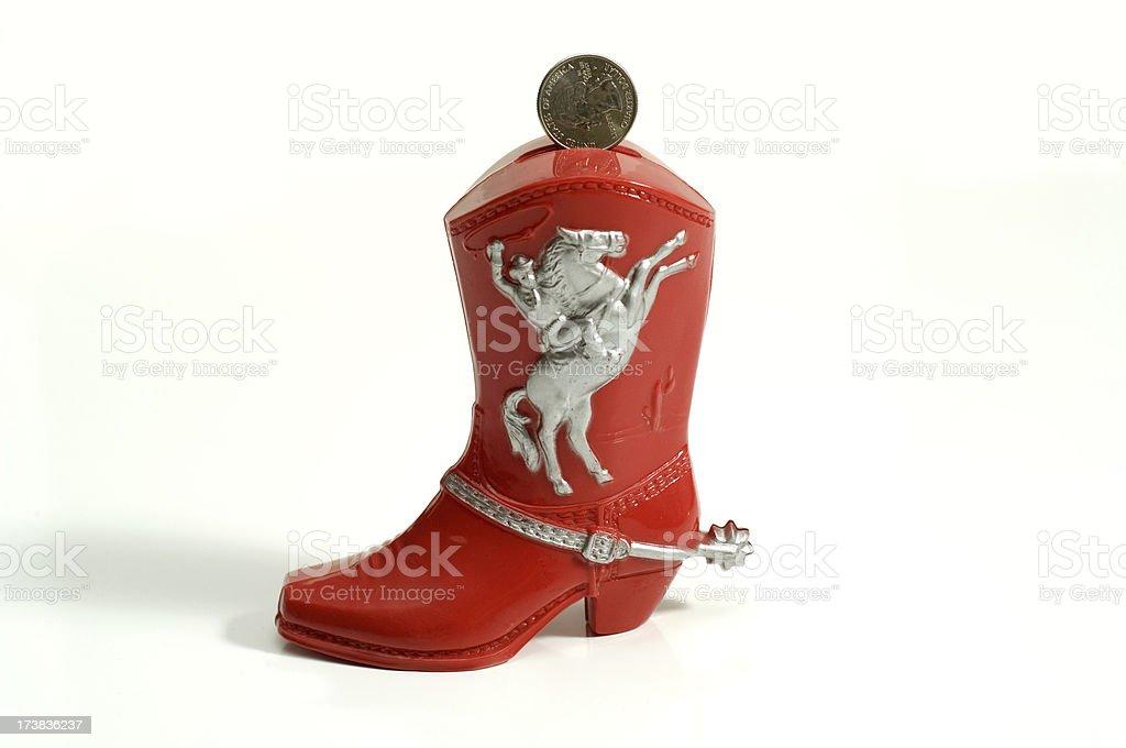Cowboy Boot Coin Bank royalty-free stock photo