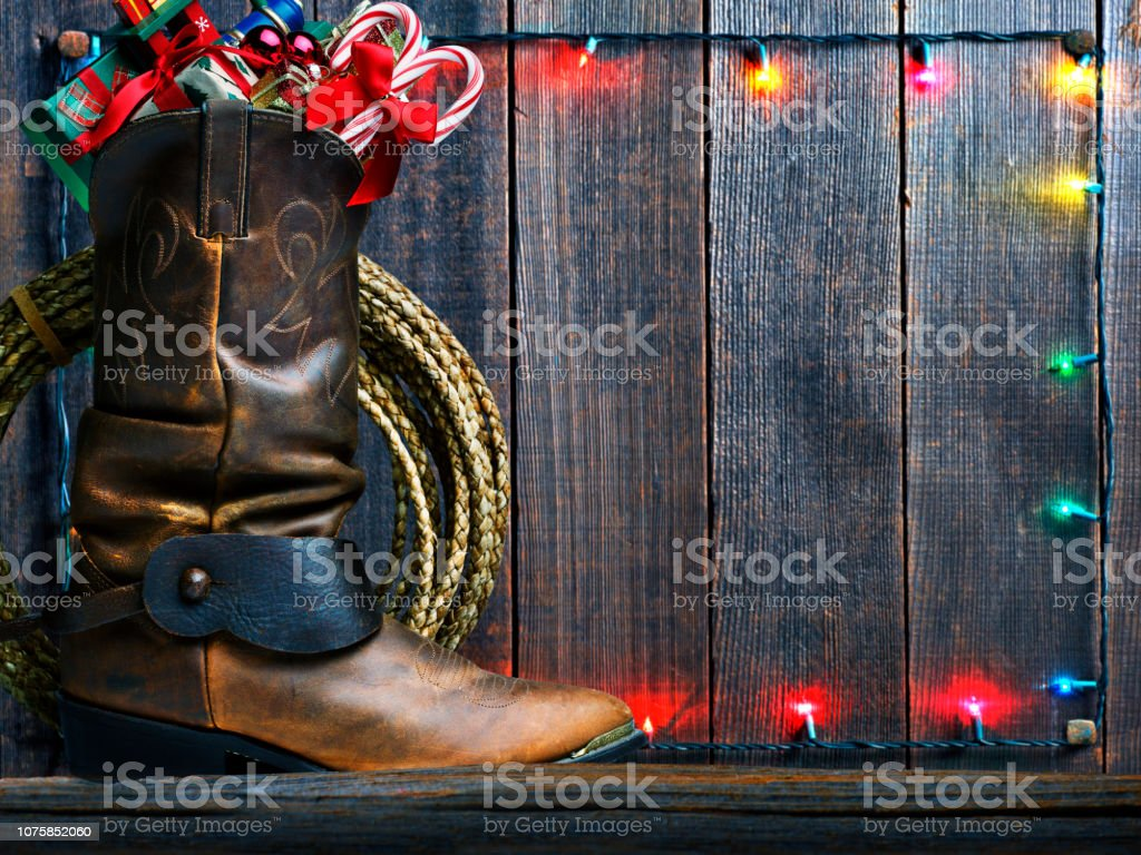 Cowboy Boot Stuffed With Christmas Presents stock photo