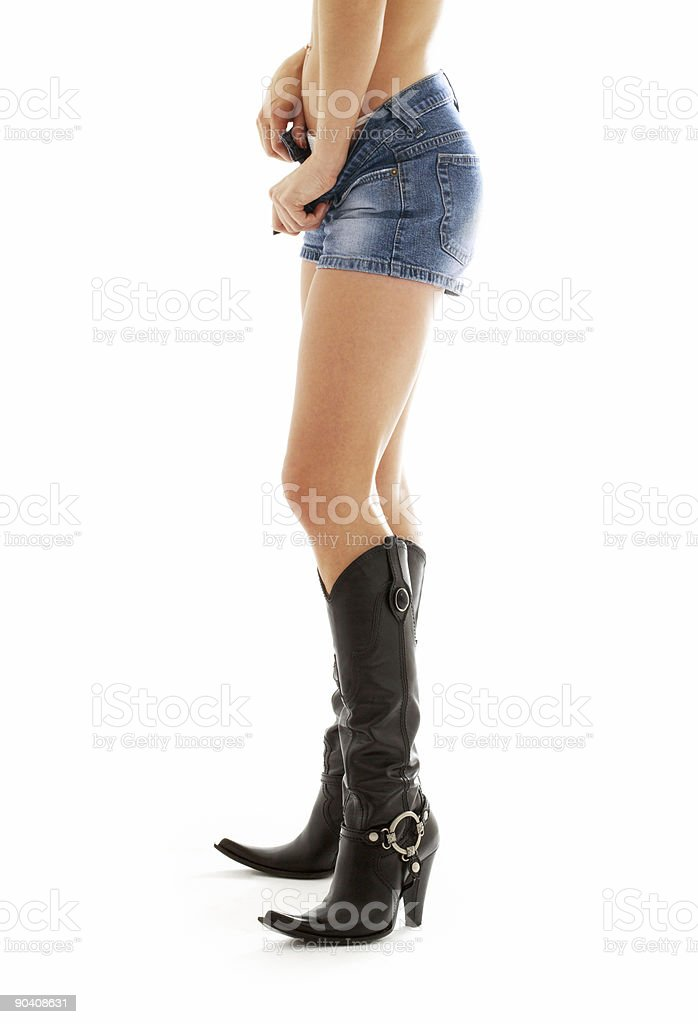 cowboy boots and denim stock photo