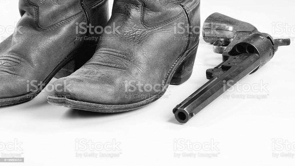 Cowboy boots and Guns. stock photo