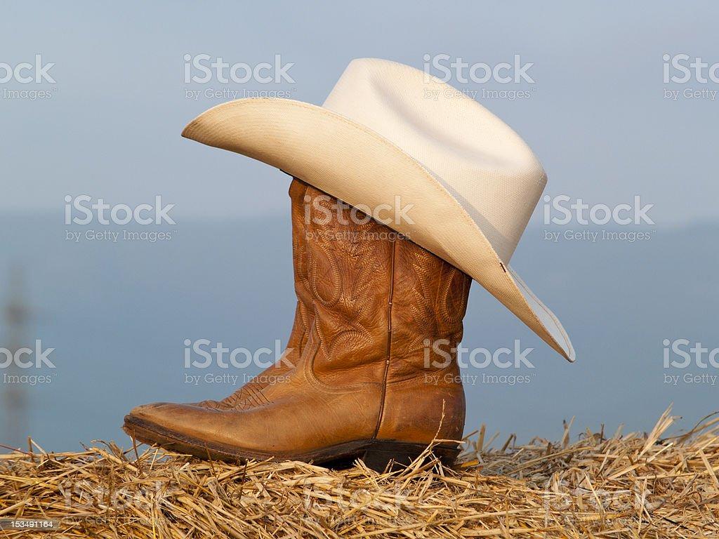 Botas y sombrero de vaquero - foto de stock