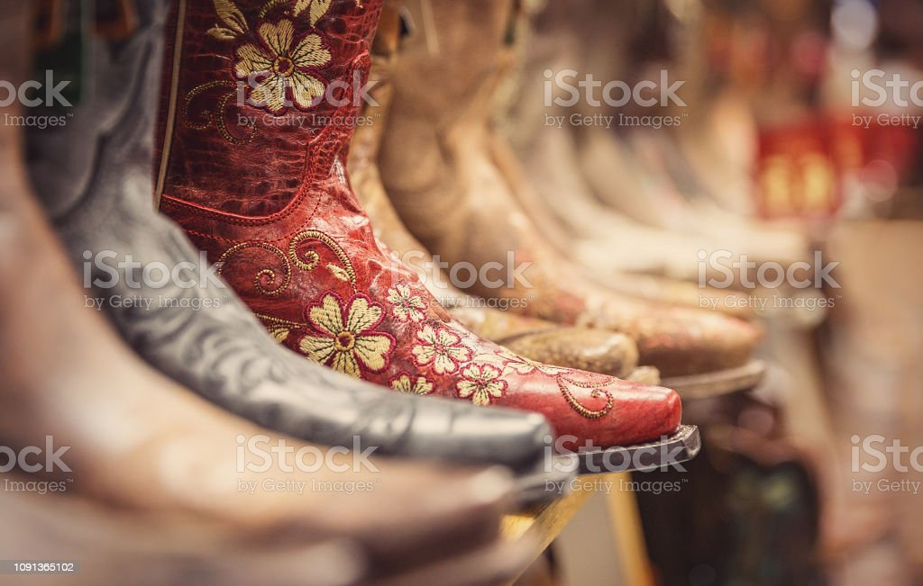 Cowboy boots in a store, vintage style shoes stock photo