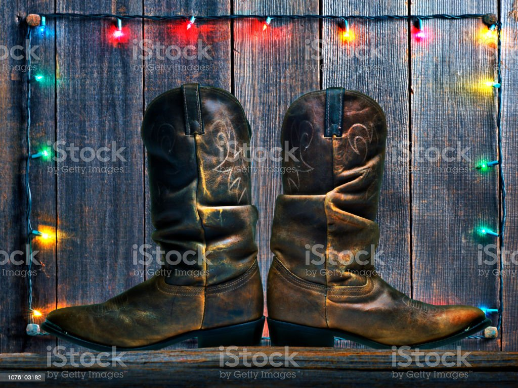Cowboy Boots In Front Of Christmas Lights stock photo