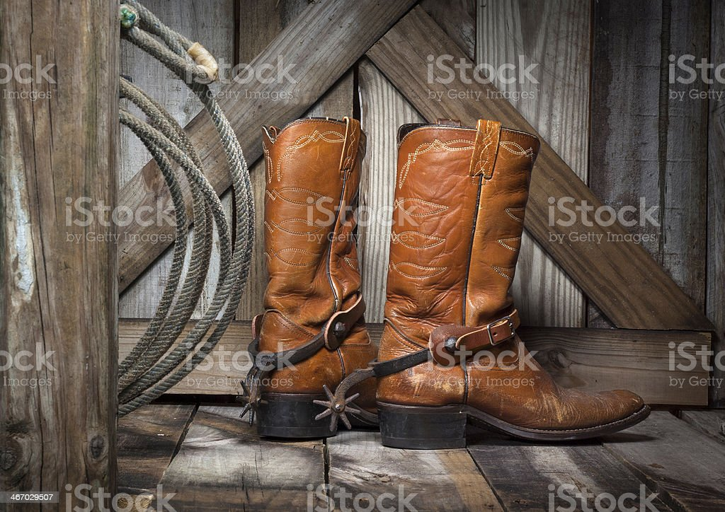 cowboy boots on a country porch stock photo