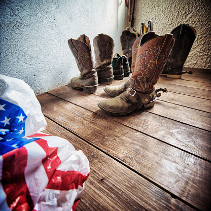 Cowboy Boots on the Floor and Shoppingbag with American Flag