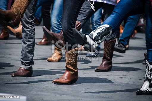 Line dancing photo just of the boots in an urban setting.