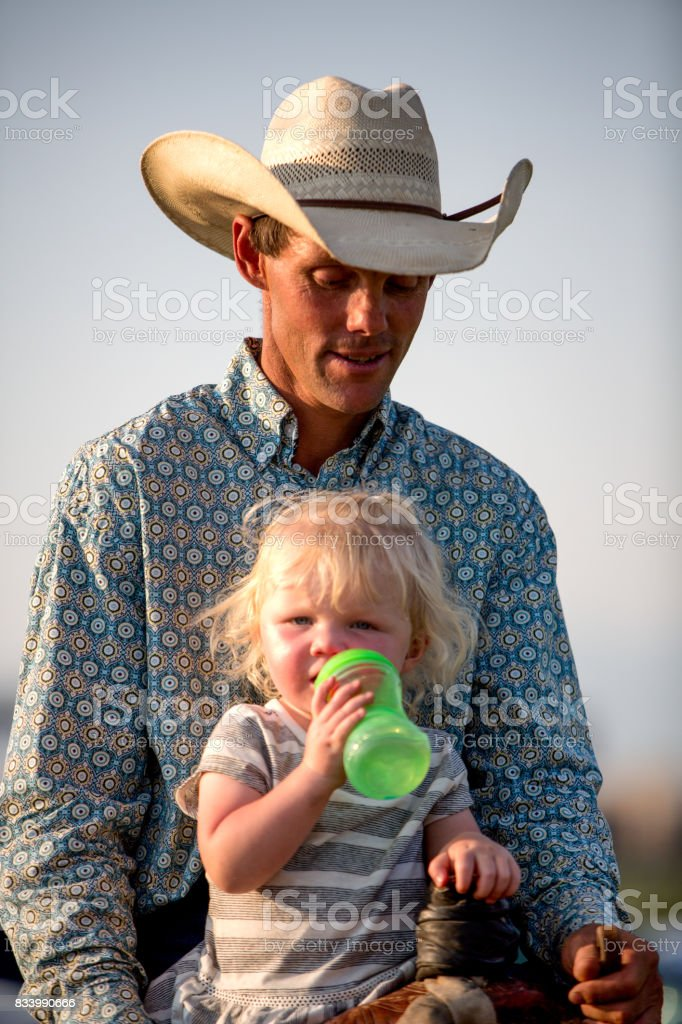 449a05af1 Cowboy Dad And Two Year Old Girl Stock Photo - Download Image Now ...