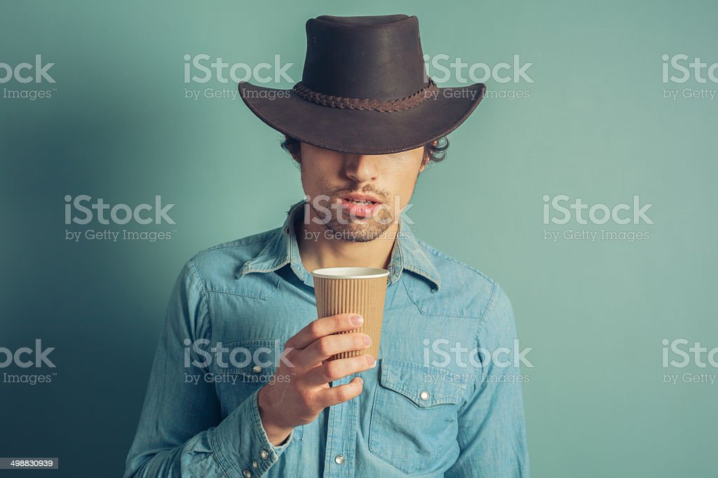 Cowboy drinking coffee stock photo