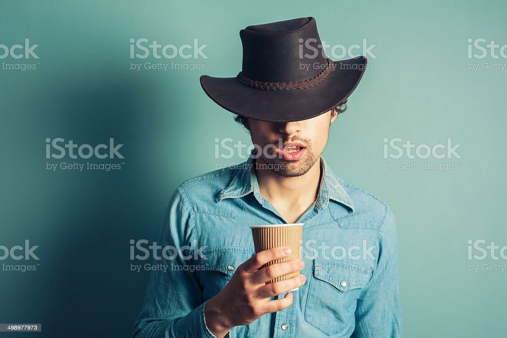 Cowboy drinking coffee stock photo