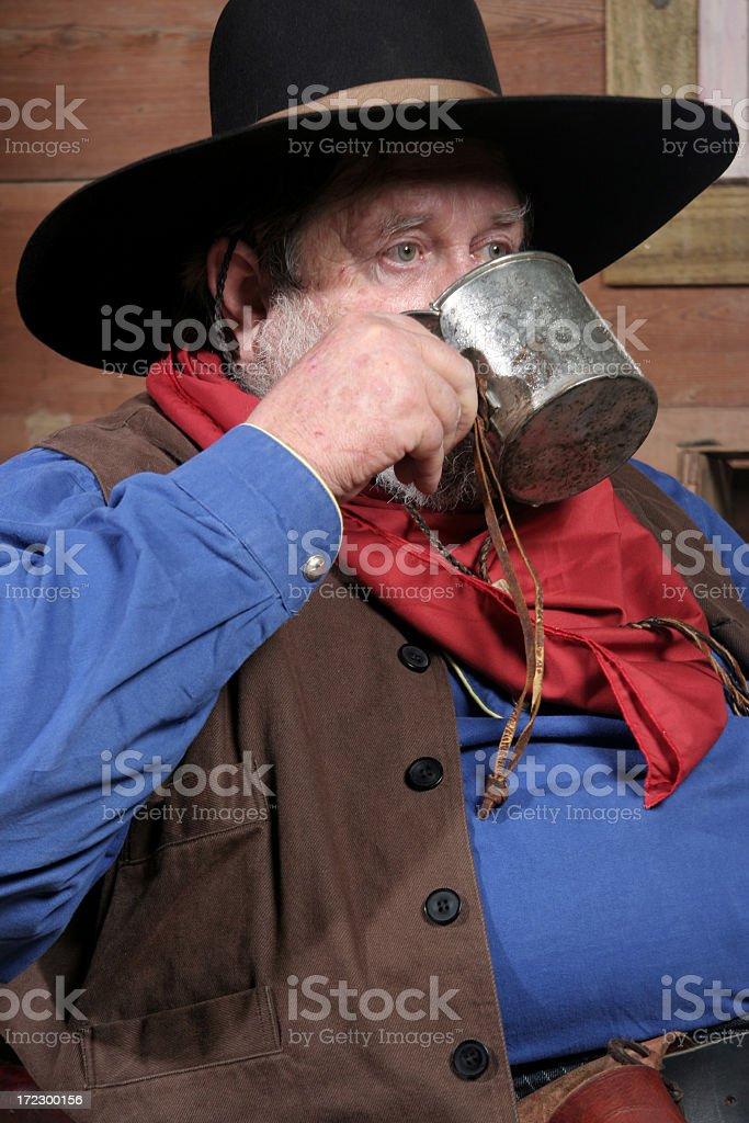 Cowboy Drinking (Close Up) stock photo