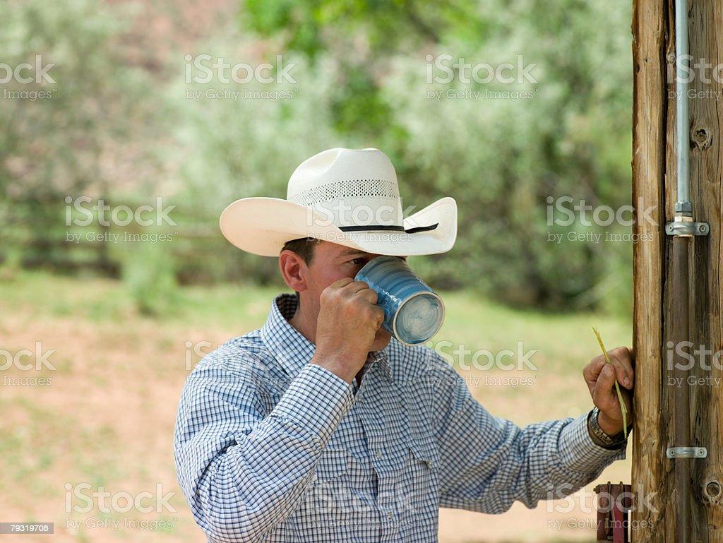 Cowboy drinking stock photo