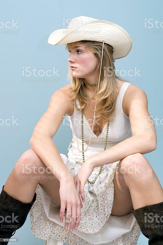 Cowboy Girl Sitting stock photo