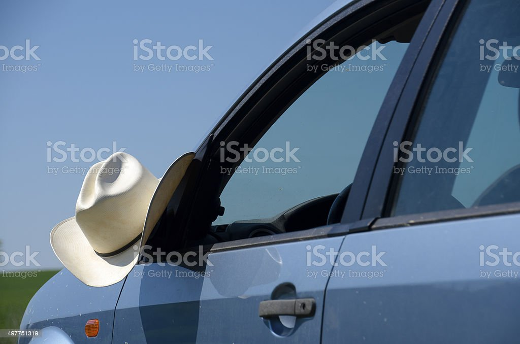 Cowboy hat and car royalty-free stock photo