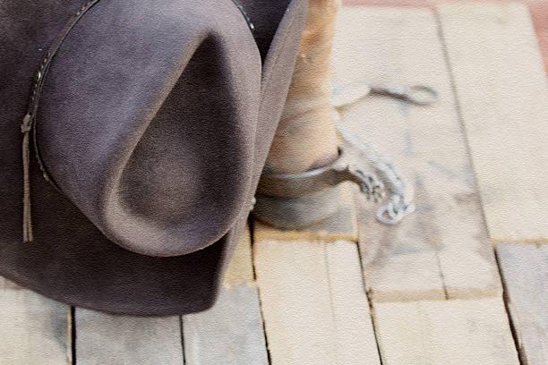 Cowboy hat, boots, spurs and a bit. stock photo