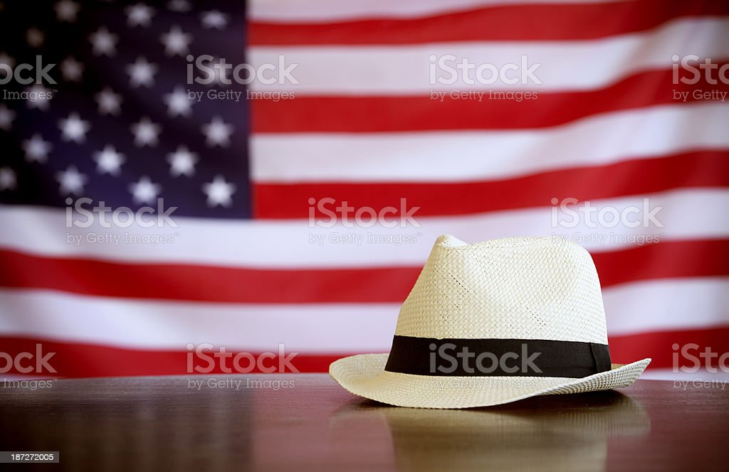 cowboy hat on an American flag royalty-free stock photo