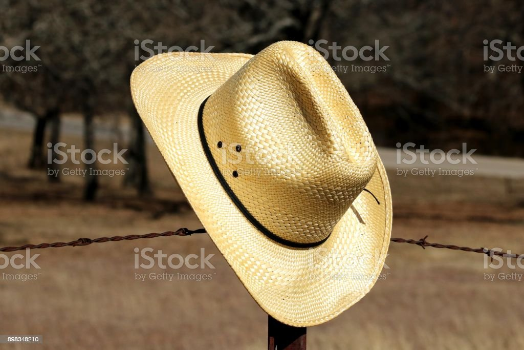 Cowboy Hat on Fence Close-up stock photo