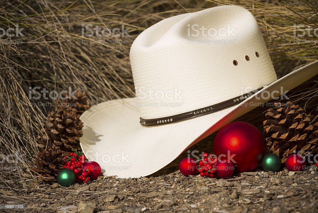 cowboy hat with christmas decorations royalty free stock photo