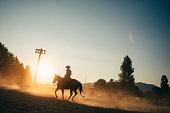 Cowboy Horseback riding at rodeo arena