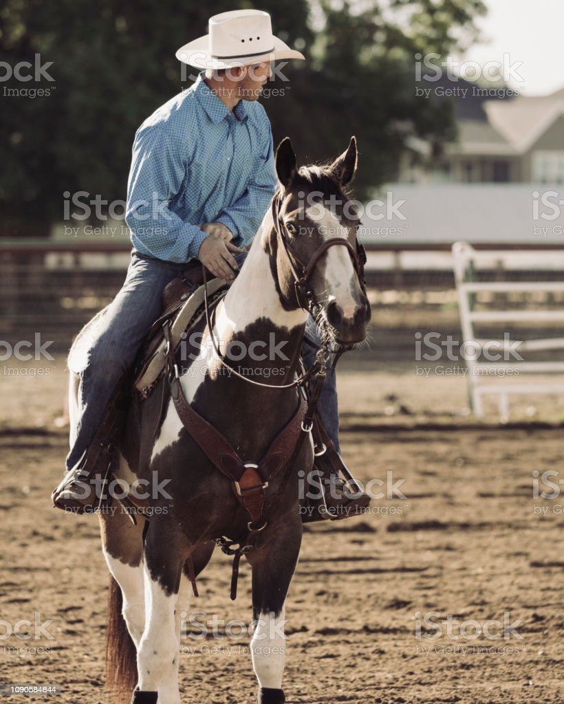Cowboy Horseback Riding On The Farm Stock Photo Download Image Now Istock