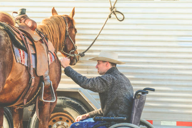 Cowboy In A Wheelchair And His Horse stock photo