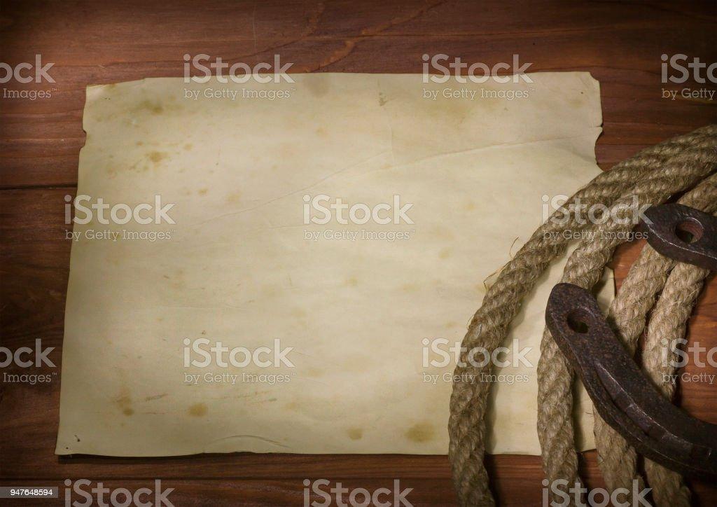 Cowboy lasso and horseshoe stock photo