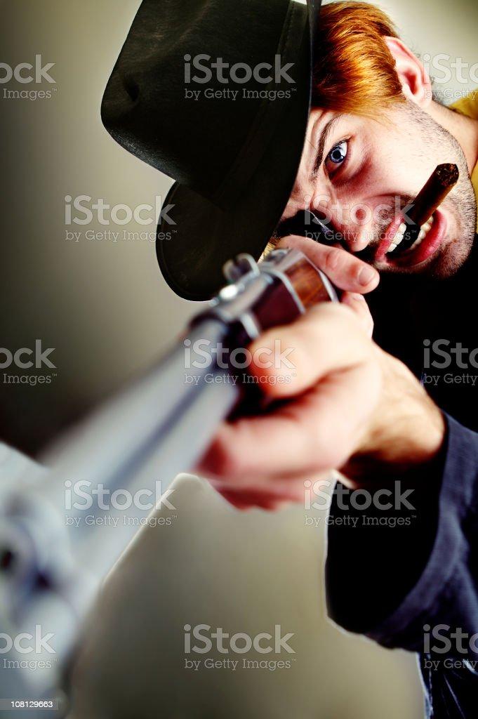 Cowboy Man Holding Rifle and Smoking Cigar royalty-free stock photo