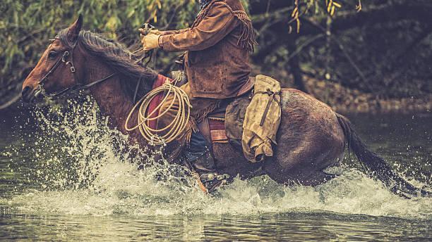 Cowboy on a horse riding across a river picture id516898796?b=1&k=6&m=516898796&s=612x612&w=0&h=furpbitmtre36cxzx91r8s2vzj7jgllyrnskn0ttmsy=