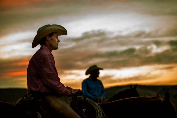 Cowboy on Horseback at Sunset stock photo