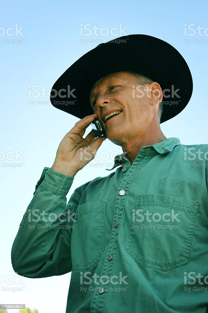 Cowboy on the phone royalty-free stock photo