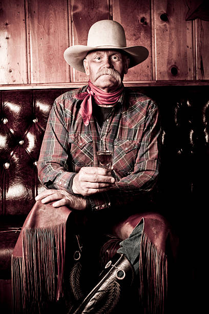 Cowboy Genuine wrangler having a drink saloon stock pictures, royalty-free photos & images