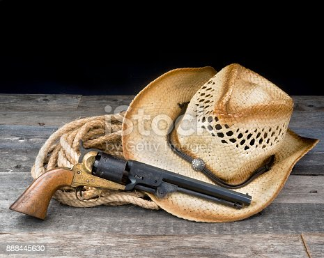 Cowboy pistol , straw hat and rope with room for your type.