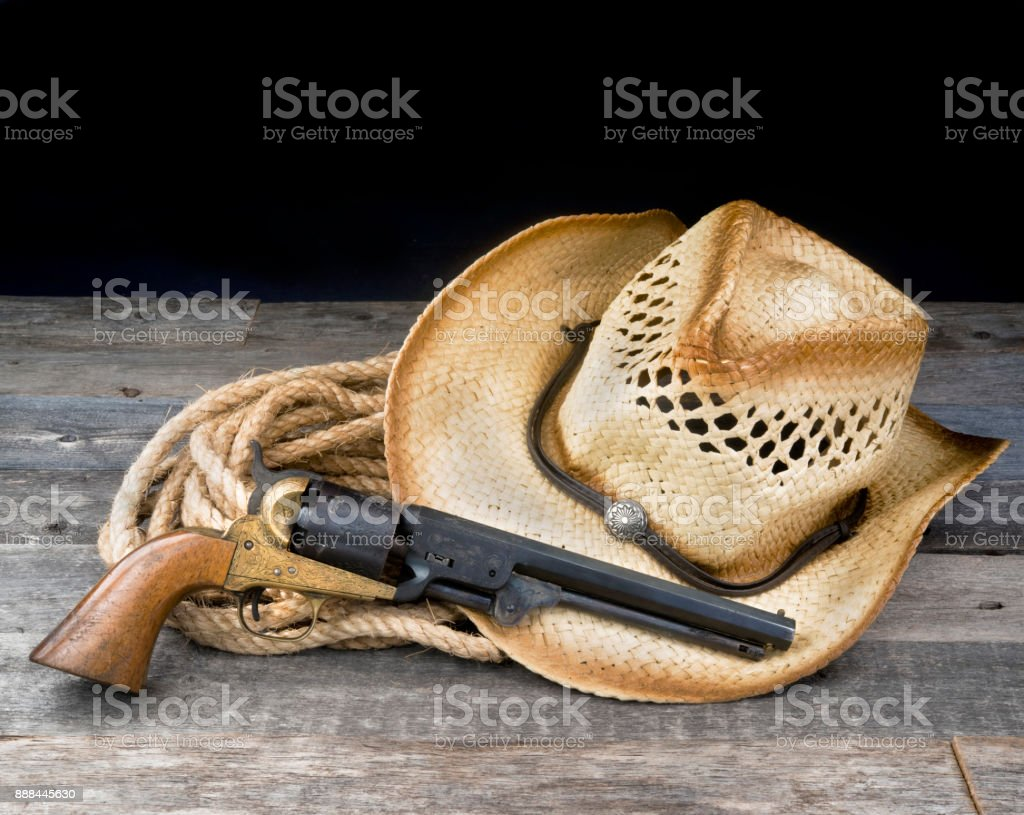Cowboy Pistol and Hat. stock photo