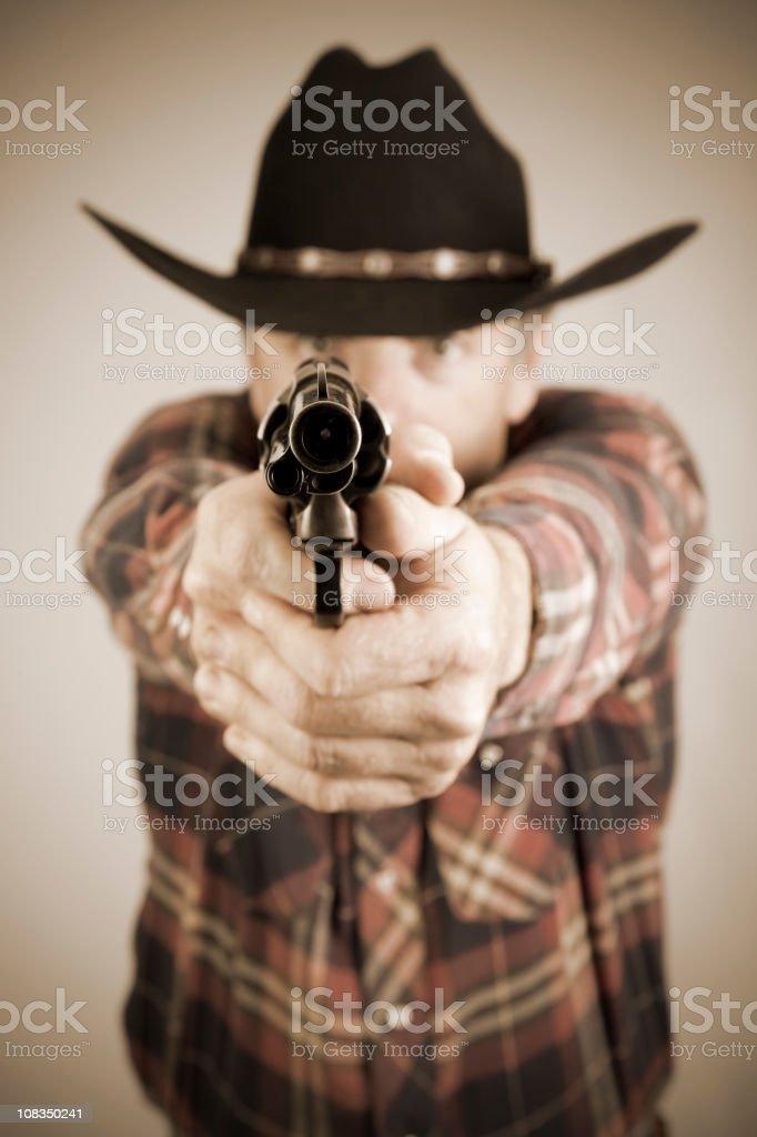 Fotografía de Cowboy Un Arma Apuntando A La Cámara y más banco de ...