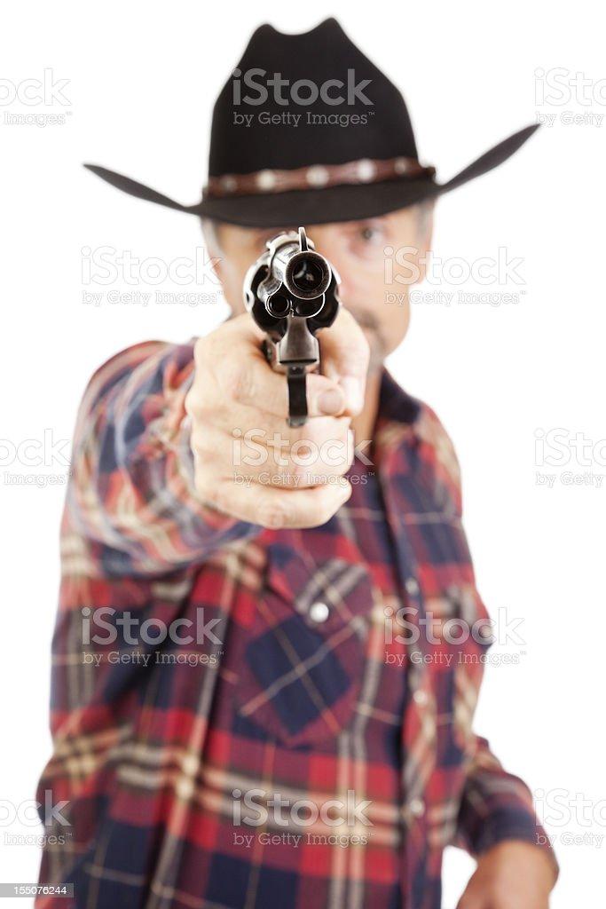 Cowboy pointing a gun at the camera royalty-free stock photo