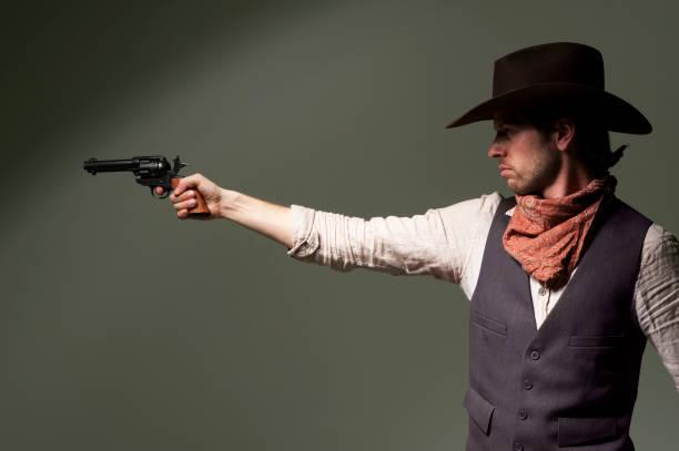 Cowboy Pointing a gun stock photo