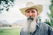 Portrait of a Senior Cowboy with long white beard