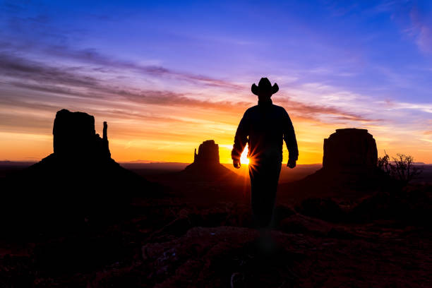 Cowboy Rancher in Monument Valley Arizona Cowboy Rancher in Monument Valley Arizona - Scenic Mittens buttes with rancher at sunsrise in Monument Valley, Arizona USA. navajo sandstone formations stock pictures, royalty-free photos & images