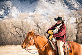 Cowboy rides with his dog in Montana