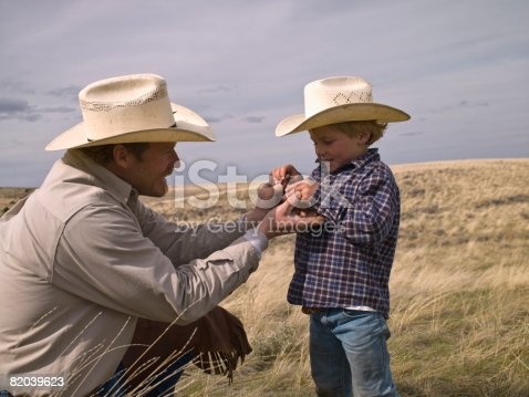 Father teaching son about local insects on property in Big Timber, Montana