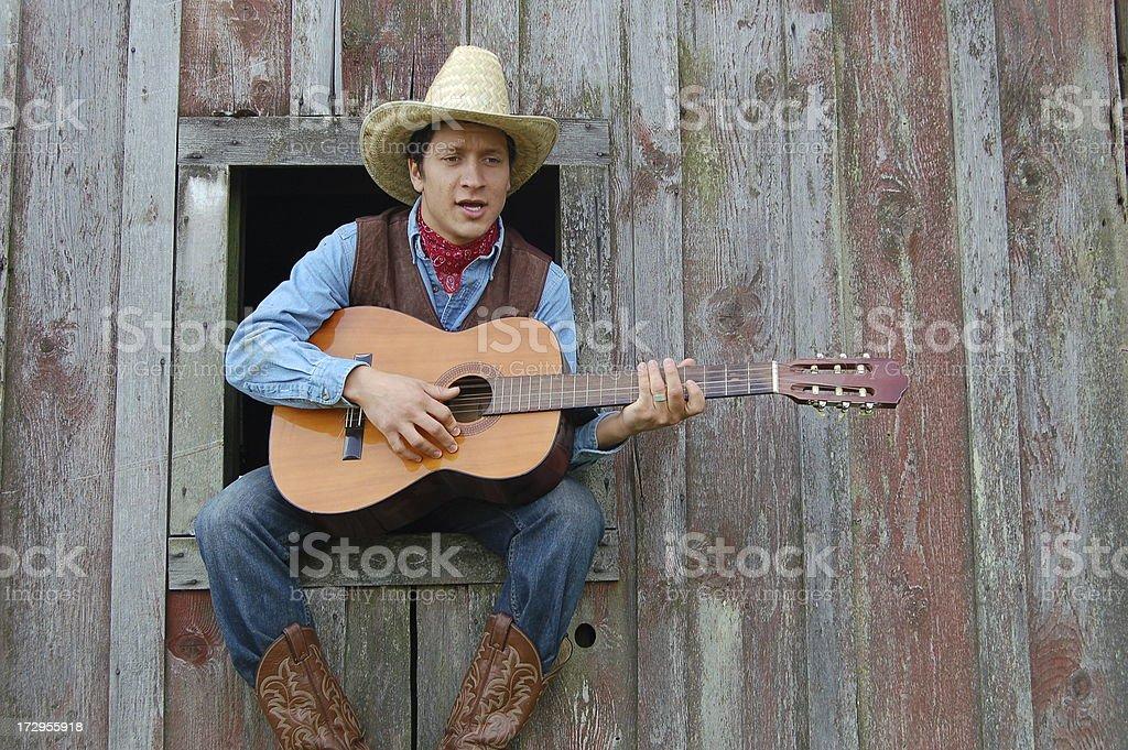 Cowboy Sings stock photo