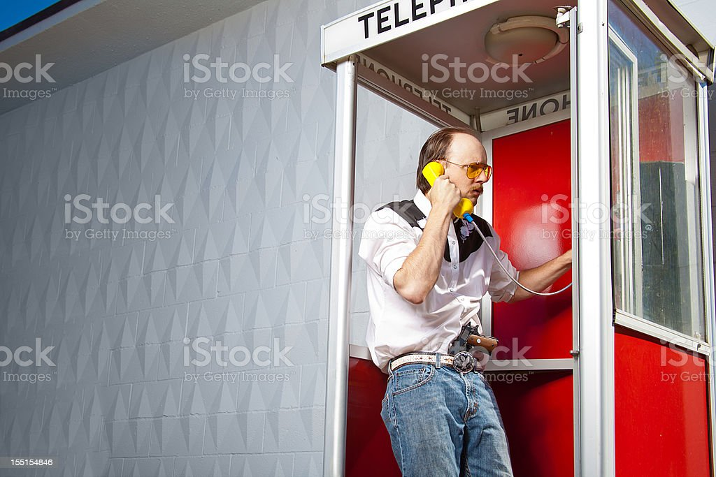 Cowboy Spy Man in phone booth gun & glasses western royalty-free stock photo