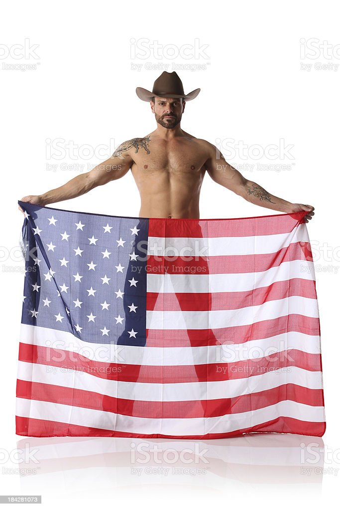 Cowboy standing with an American flag royalty-free stock photo