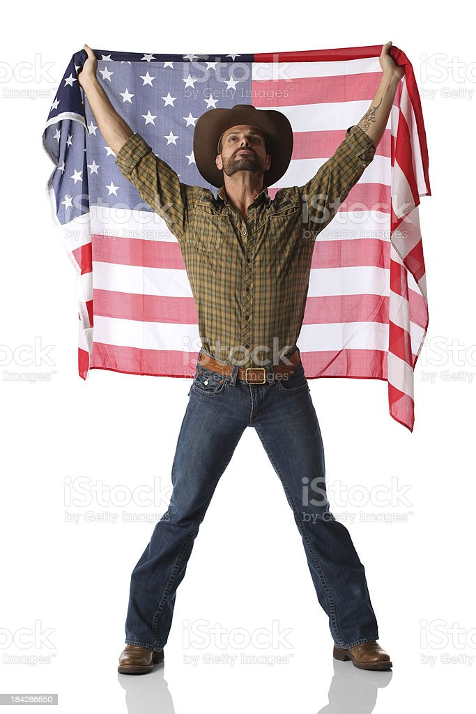 Cowboy standing with an American flag stock photo
