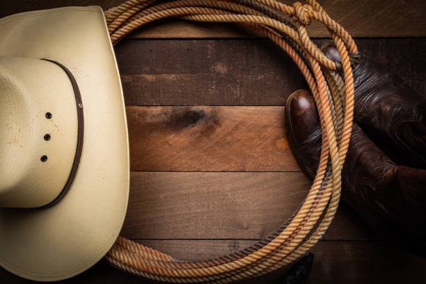 cowboy supplies on wood background - west direction stock pictures, royalty-free photos & images