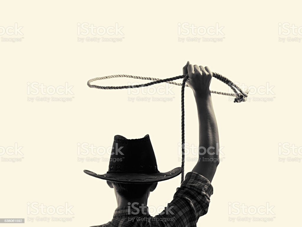 cowboy throws a lasso stock photo