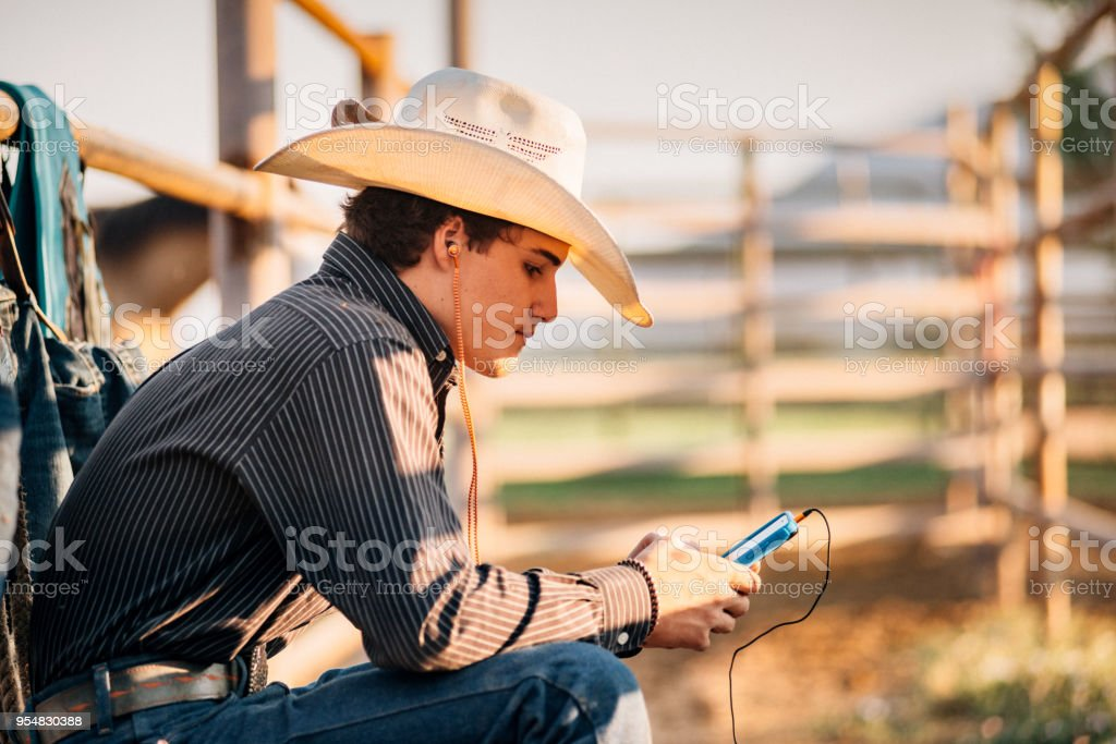 Cowboy using Smartphone stock photo