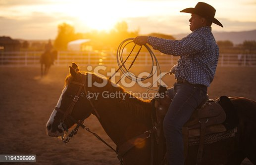 Cowboy warming up before event at a rodeo arena