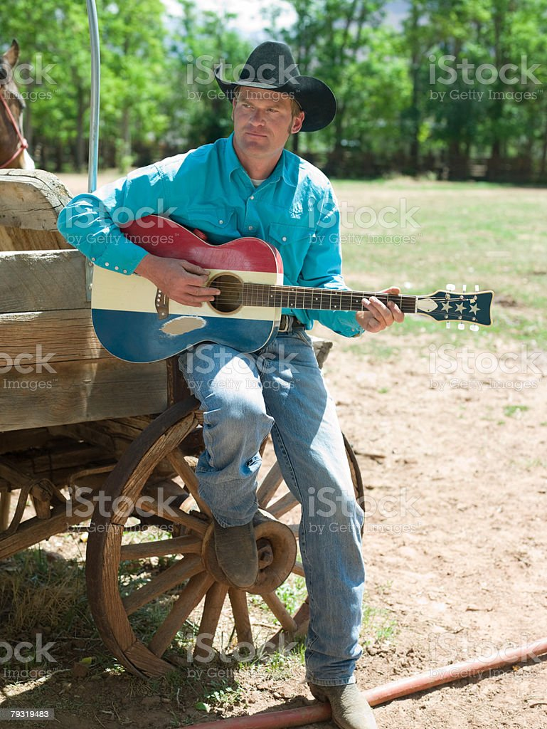 Cowboy with a guitar 免版稅 stock photo